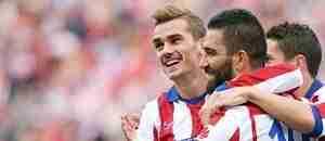 Griezmann Turan celebran gol